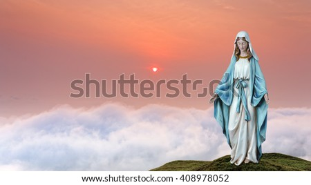 Statue of the Virgin Mary over heavenly sky concept of religion - stock photo