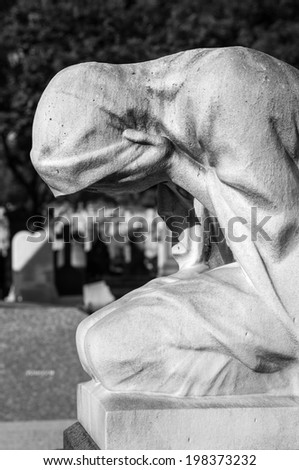 Statue of weeping woman on a grave (Black and White) - stock photo
