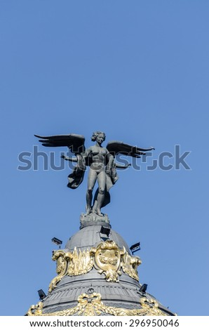 Statue of winged women on top of building in Spain - stock photo