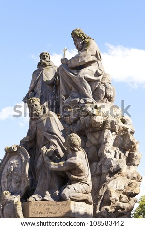 Statue on Charles bridge in Prague, Czech Republic - stock photo