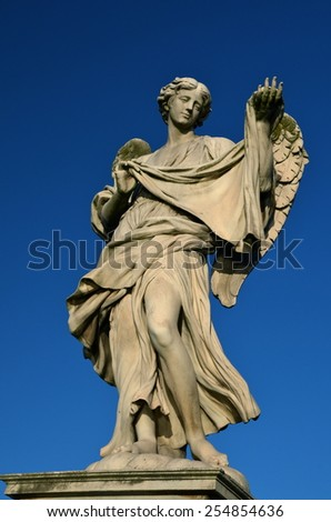 Statue on Ponte Sant'Angelo in Rome, Italy - stock photo