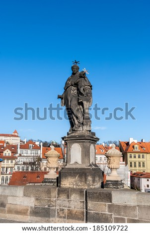 Statue on the Charles Bridge (Karluv most, 1357), a famous historic bridge that crosses the Vltava River in Prague, Czech Republic. Bridge is decorated by 30 statues, originally erected around 1700.