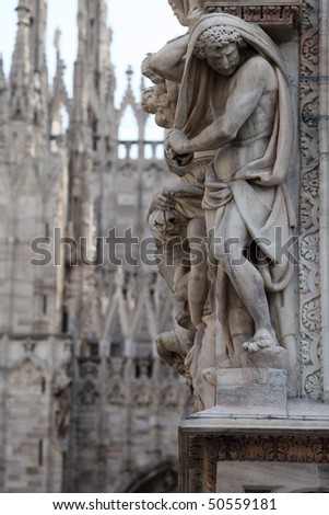 Statue on the Milan Cathedral. Gothic architecture - stock photo
