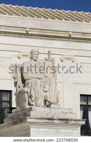 Statue outside the Supreme Court of the United States in Washington D,C.  - stock photo