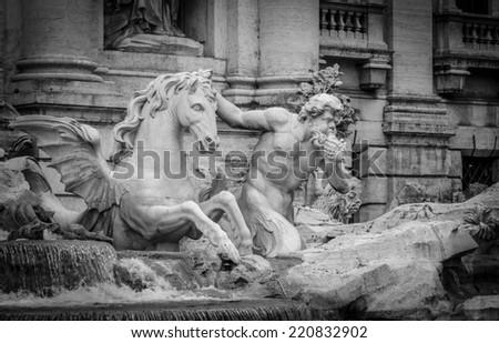 statue representing a triton with his horse at Trevi Fountain (Fontana di Trevi) Rome, Italy - stock photo
