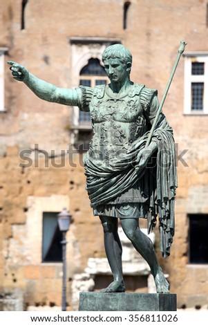 Statue S.P.Q.R. IMP CAESAR Augustus PATRIAE PATER on street Via dei Fori Imperiali, Rome, Italy - stock photo