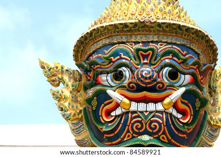 Statue the face giant at Wat Phra Kaew in Bangkok, Thailand - stock photo