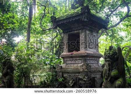 Statues and offerings at the monkey temple, Ubud, Bali, Indonesia - stock photo