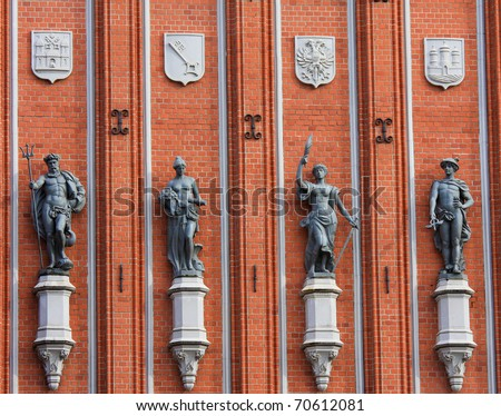 Statues at the famous House of the Blackheads in Riga, Latvia. - stock photo