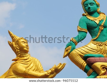 Statues of angels by the Act. The story of the Buddha. On the arch. - stock photo