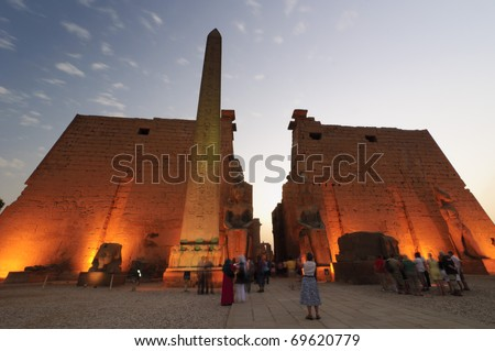 Statues of Ramses II and Obelisk of Luxor Temple. Luxor, Egypt - stock photo