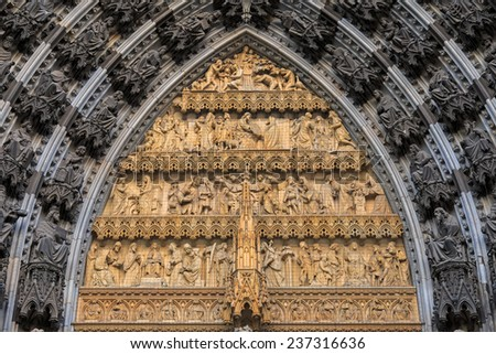 Statues of the saints above the entrance of Cologne cathedral, Germany  - stock photo