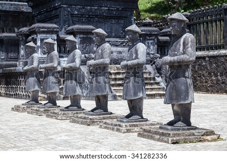 Statues of warriors in Imperial Khai Dinh Tomb in Hue, Vietnam - stock photo