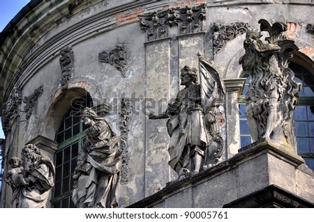Statues on Cathedral at Pidhirtsi, Pidhirtsi Castle near Lviv - stock photo