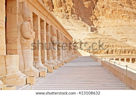 Statues on facade of palace of Hatshepsut in Luxor, Egypt - stock photo