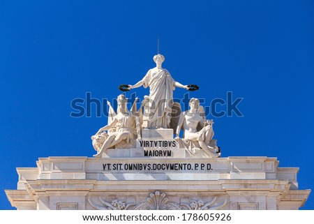 Statues on top of the gate on the Commerce square in Lisbon, Portugal - stock photo
