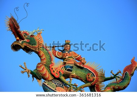 Statues on traditional Chinese temple with blue sky