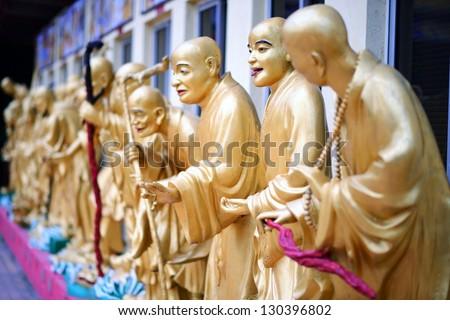 Statues sat Ten Thousand Buddhas Monastery in Sha Tin, Hong Kong, China. - stock photo