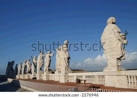 statues standing on the roof of St.Petre basilica - stock photo