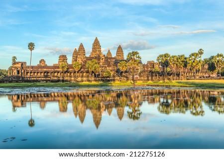 Status of Angkor Wat in sunset the golden shine, the best time in the evening at Siem Reap, Cambodia - stock photo