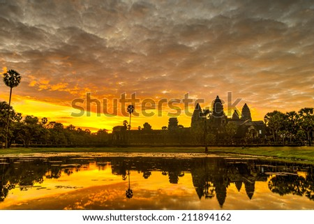Status silhouette of Angkor Wat in sunrise, the best time in the morning at Siem Reap, Cambodia - stock photo