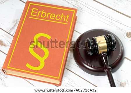 Statute book with the German words Law of Succession and Judges gavel / Statute book - stock photo
