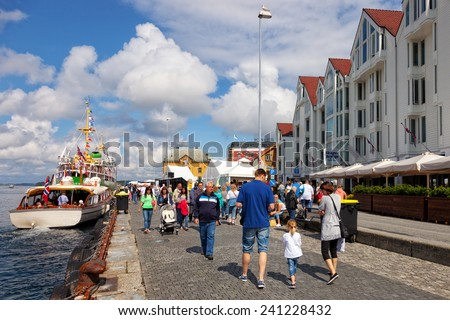 STAVANGER, NORWAY - JULY 20: Lot of Tourists walking, shopping and sightseeing at Old Town, on July 20, 2011 in Stavanger, Norway. Stavanger is one of most famous cruise travel destinations in Europe. - stock photo