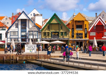 STAVANGER, NORWAY - JULY 15, 2015: People at the quay port with many restaurants and pubs in the city centre of Stavanger. Stavanger is one of most famous cruise travel destinations in Europe. - stock photo