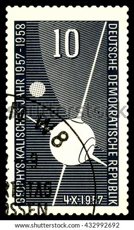 STAVROPOL, RUSSIA - APRIL 30, 2016: a stamp printed  in  GDR  shows first Sputnik, circa 1957 - stock photo