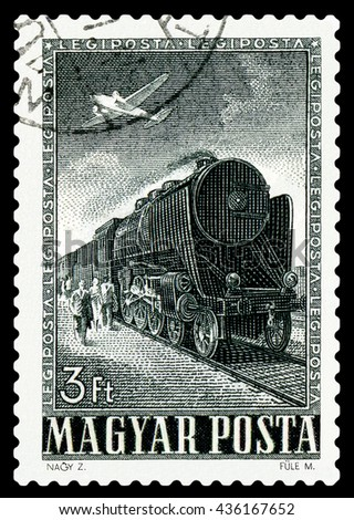 STAVROPOL, RUSSIA - APRIL 03, 2016: A Stamp printed in Hungary shows old  Lokomotive and plane,  circa 1955 - stock photo