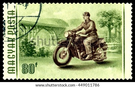 STAVROPOL, RUSSIA - MARCH 16, 2016:: A stamp printed in Hungary shows image of a motorcyclist,  circa 1958 - stock photo