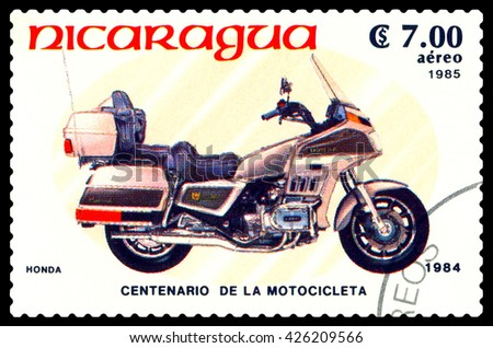 STAVROPOL, RUSSIA - MAY 24, 2016: a stamp printed in Nicaragua, shows an motorcycle Honda,  stamp devoted to the centenary of the invention of motorcycle , cirka 1984 - stock photo