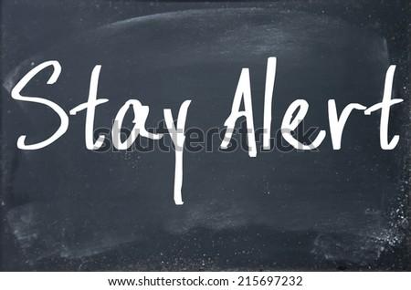 stay alert text write on blackboard - stock photo