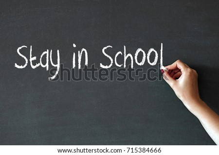 Stay in school written on chalkboard blackboard. Hand writing with chalk great texture