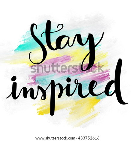 Stay inspired motivational hand lettering message on colorful painted background - stock photo