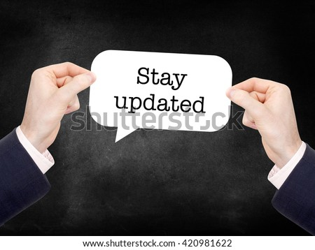 Stay updated written on a speechbubble - stock photo