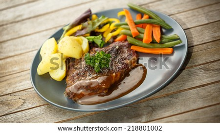 Steak and vegetables - stock photo