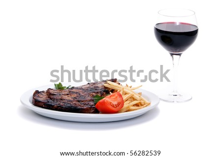 Steak dinner with french fries - stock photo