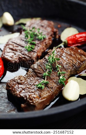 Steak in frying pan close up - stock photo