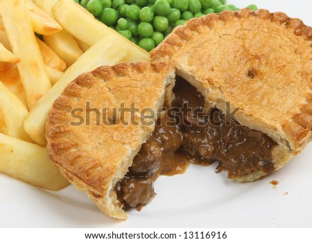 Steak & kidney pie with chips and peas - stock photo