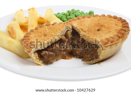 Steak & kidney pie with puff-pastry top - stock photo