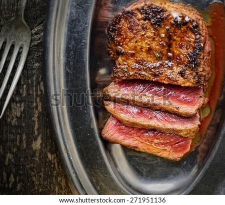 steak medium roasting on a platter - stock photo