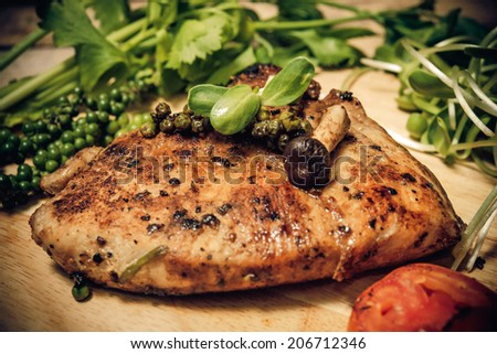 steak on a wooden table.  - stock photo