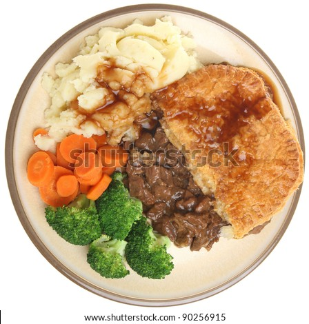 Steak pie with mashed potato, vegetables & gravy. - stock photo