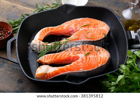 Steak Salmon on a grill pan. Cooking Red Fish - stock photo