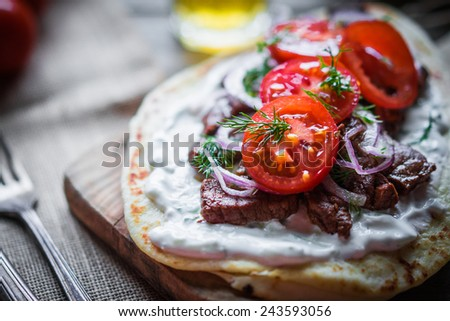Steak sandwich with vegetables - stock photo