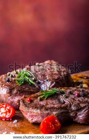 Steak. Steak. Grill beef steak. Portions thick beef juicy sirloin steaks on grill teflon pan or old wooden board. See the full set of 100 amazing photos - stock photo