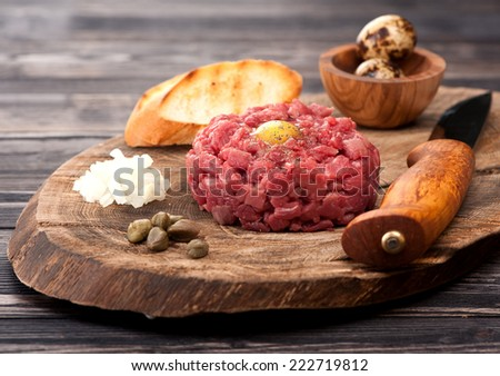 Steak Tartare with capers and fresh onions  - stock photo