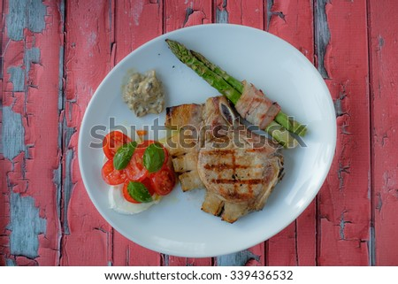 Steak with aspargus and some vegetables - stock photo