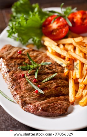 Steak with Chips - stock photo
